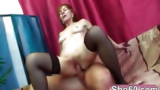 Redhead slim granny strips for younger handsome cock and rides it like she a young girl again