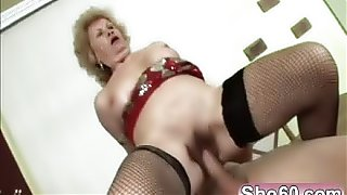 Busty granny gets her pussy satisfied by a young stud