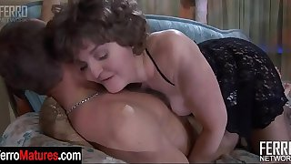 Greedy mature lady in lacy undies and hosiery seducing a handsome young guy