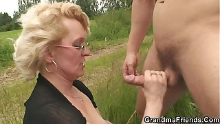 Old whore takes two dicks outdoor
